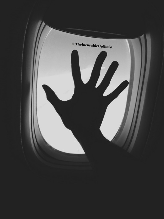 Silhouette of a Hand on a Window