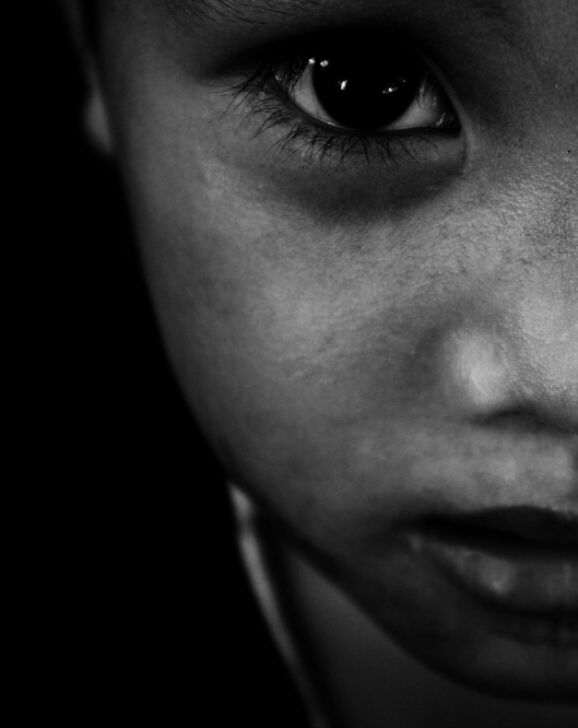 Black and White Portrait of a Child's face.