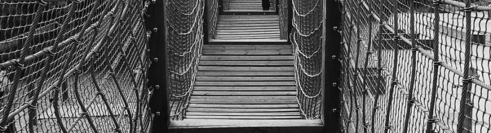 Picture of a Woman walking on a foot bridge