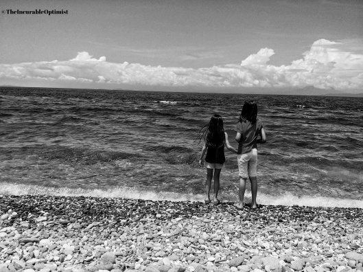 Black and white Picture of two girls on a beach