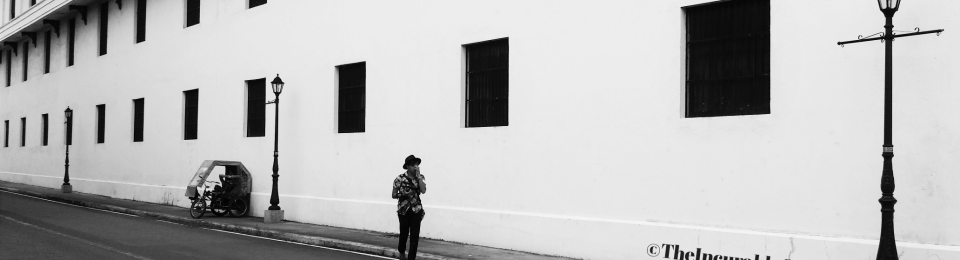 Black and White Picture of a man on a lonely Street By TheIncurableOptimist