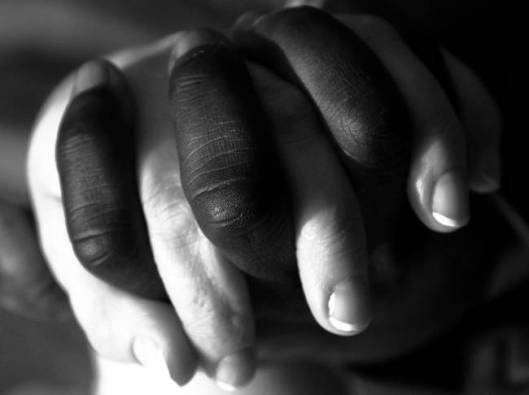 Black and White Hands holding each other