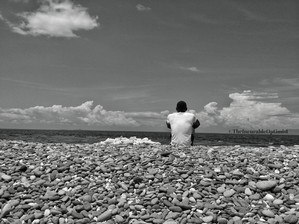 Man on a stony Beach